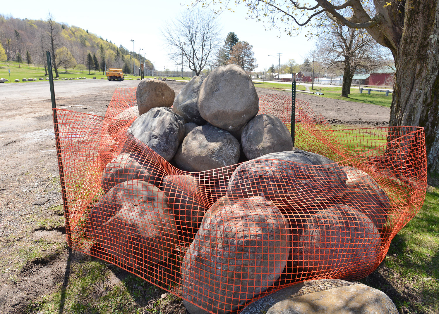 RESTING ROCKS — Rocks moved at the parking lot at Erwin Park are gathered for re-use after the expanded parking area is prepared.