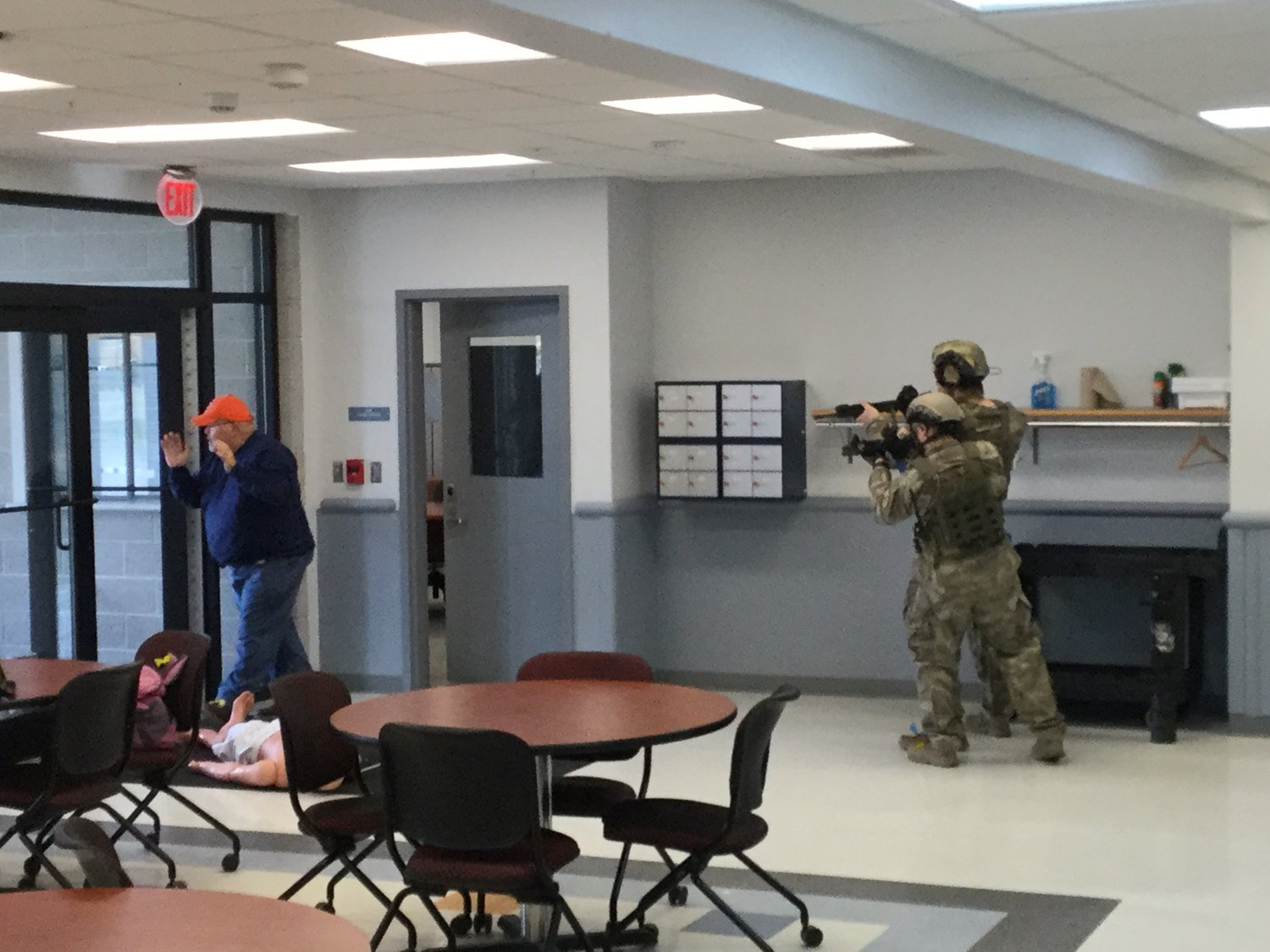 HOSTAGE FREED — A role-player hostage flees a training scenario at Tactical Week at the state Preparedness Training Center. The role-players add an extra level of realism for the officers in training.