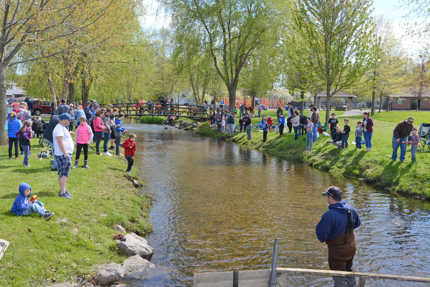 FAMILY FISHING — About 90 anglers gather at Wood Creek in the Rick LeFevre Fishing Derby at Guyer Field on Saturday. The annual event is conducted by the Rome Parks and Recreation Department with support and collaboration with the Rome Fish Hatchery. The event is named for the late Rick LeFevre, revered for his contributions to youth sports with the Recreation Department, including with youth hockey and skating at J.F. Kennedy Civic Arena. Additional photos, page 2 and online at www.romesentinel.com.