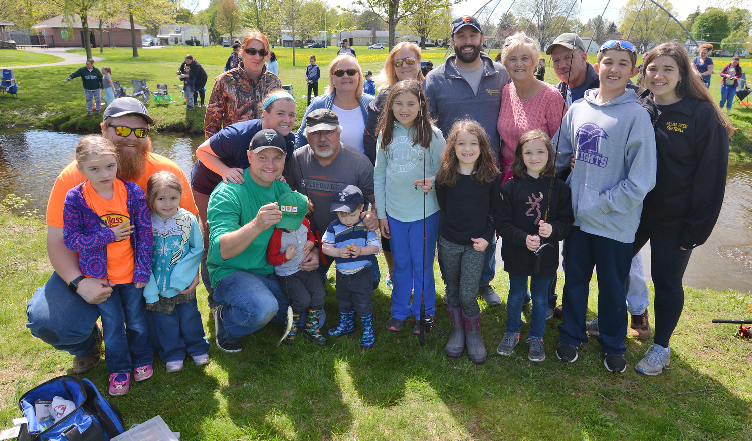 FAMILY GATHERING — Sisters and nieces and nephews of fishing derby namesake Rick LeFevre were on hand at Guyer Field to test their angling skills.