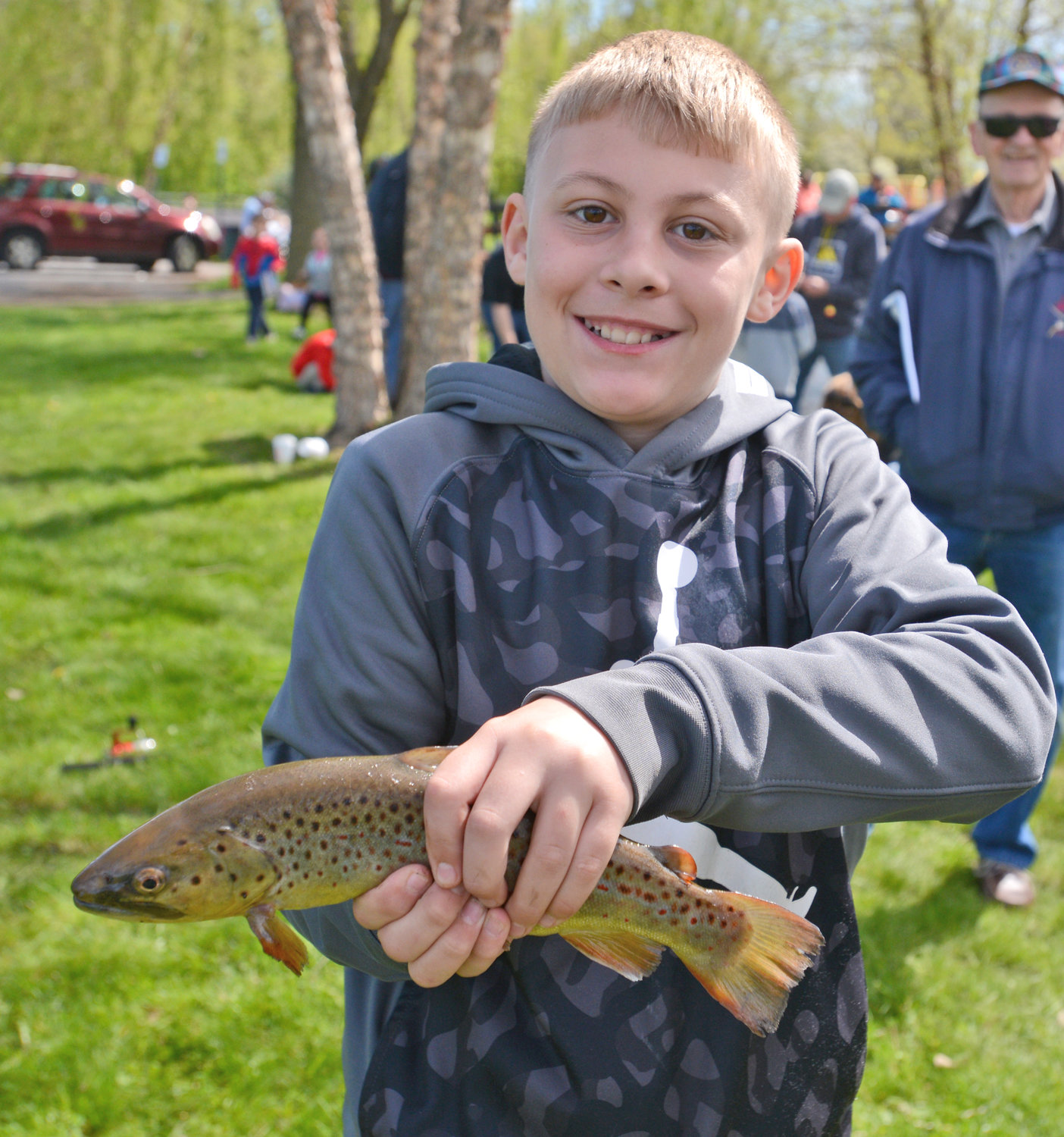 LITTLE LUNKER — Justen Hoffmeister 11, holds up the fish he caught at the Guyer Field fishing derby Saturday morning. He was with his dad, Justen Hoffmeister.