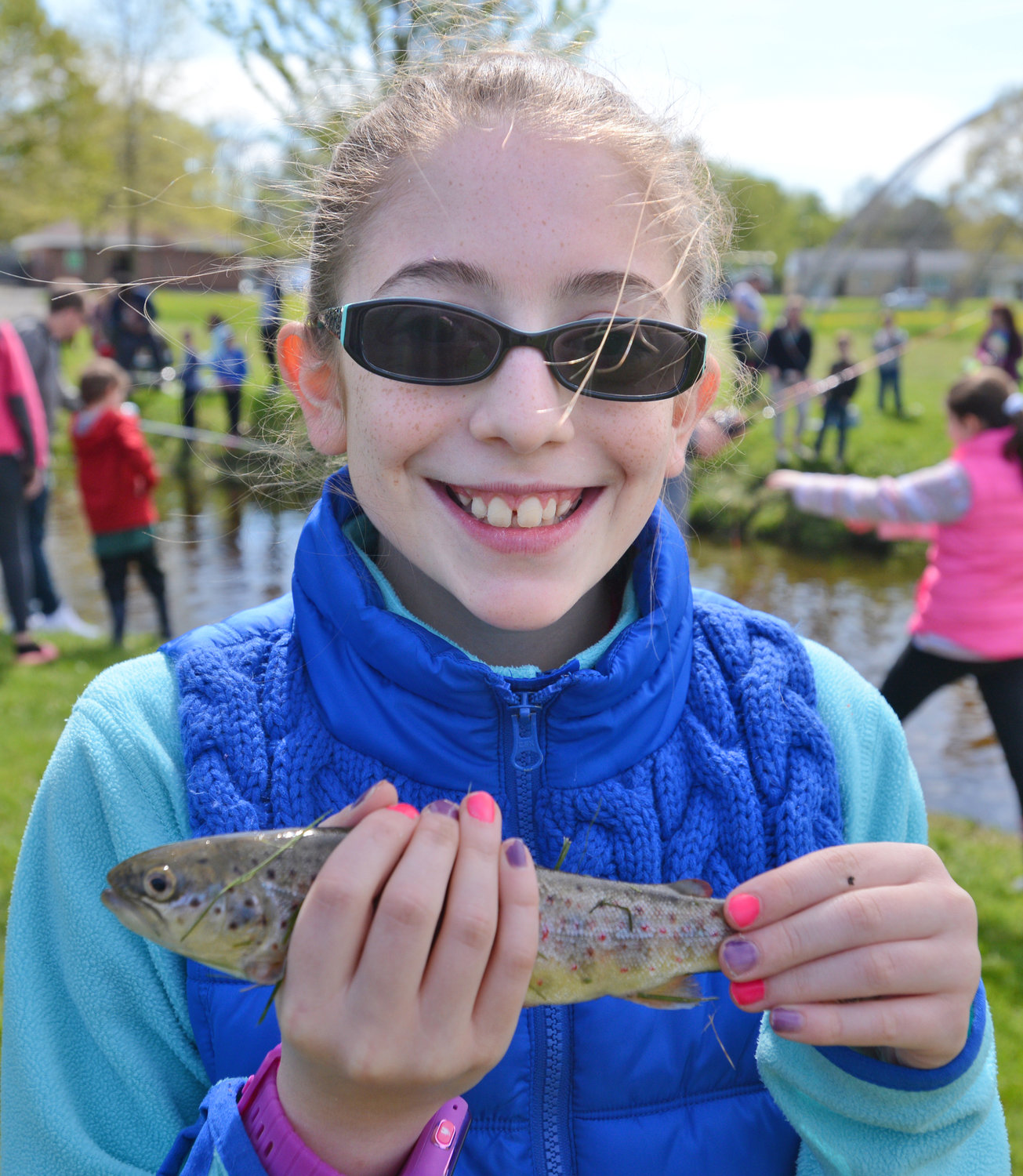 RAINBOWS — Sofia Malone, 11, holds up her catch of the day at the Rick LeFevre Fishing Derby. She was at the event with her dad, Mark Malone.