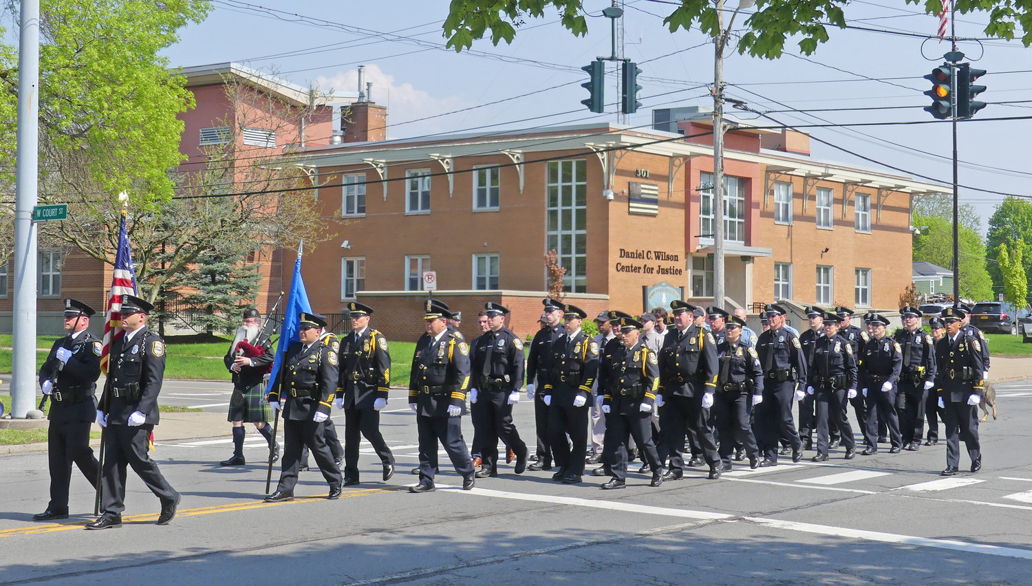 THE CITY'S FINEST — Clad in their dress uniforms, the members of the Rome Police Department march from the station to St. Paul's Church a block down North James Street for their annual awards ceremony on Sunday.