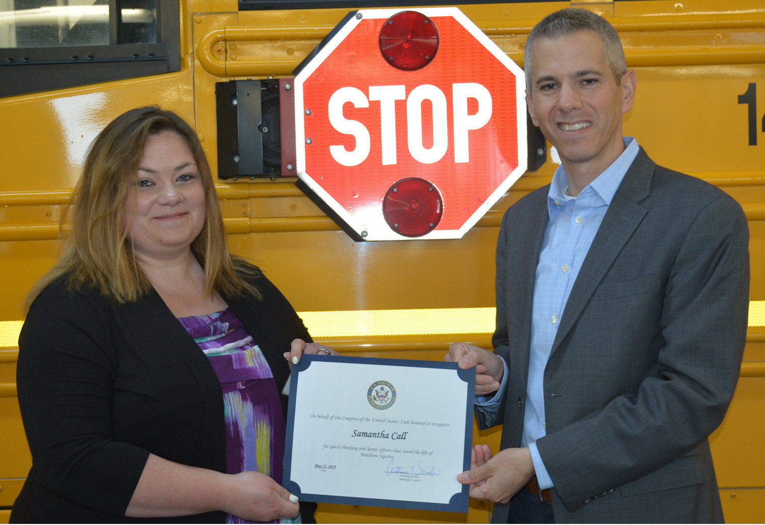 "RECOGNITION FOR HEROISM — Norwich Central School bus driver Samantha Call is awarded a certificate for ""quick thinking and heroic actions"" by Rep. Anthony Brindisi for her efforts in saving the life of 13-year-old Matthew Squires on April 26. Call grabbed the back of Squires shirt and kept him from exiting the school bus just as a car sped by the open doors that surely would have injured if not killed the child."