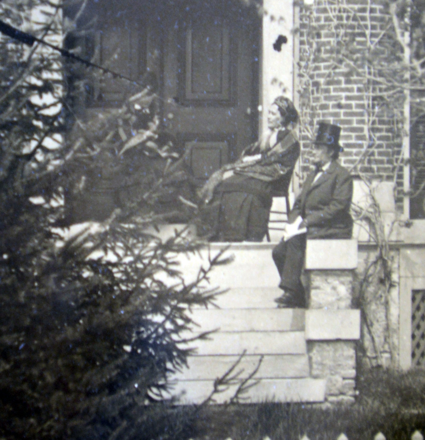 PREVIOUS OWNERS — Eliza and John B. Jervis on the front porch of their home at 613 N. Washington St. He designed the home.