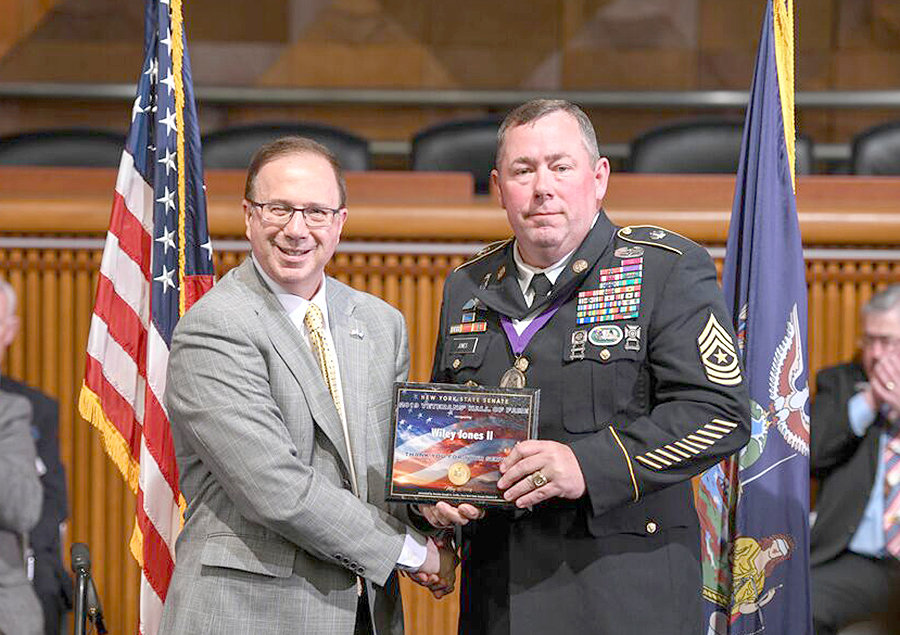 HALL OF FAMER — State Senate Deputy Minority Leader Joseph Griffo, R-47, Rome, left, presents Sgt. Major Wiley Jones, of Marcy, with a plaque in recognition of Jones's induction into the New York State Senate Veterans' Hall of Fame.