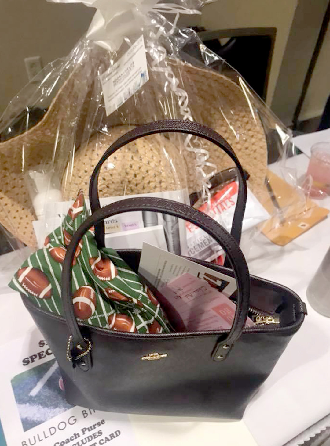 UP FOR GRABS — This designer Coach purse is just one of the handbags being raffled off at Vernon Downs this evening to support Westmoreland Pop Warner football.