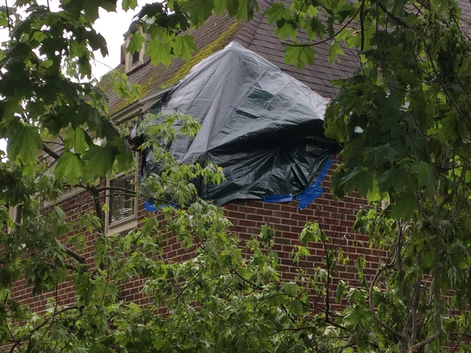 CORNER GONE — A tarp covers up the hole at 302 Maple St. in Rome this morning. Resident Bill Brain said a tree in his backyard fell and knocked out the whole corner.(Sentinel photos by Sean I. Mills)