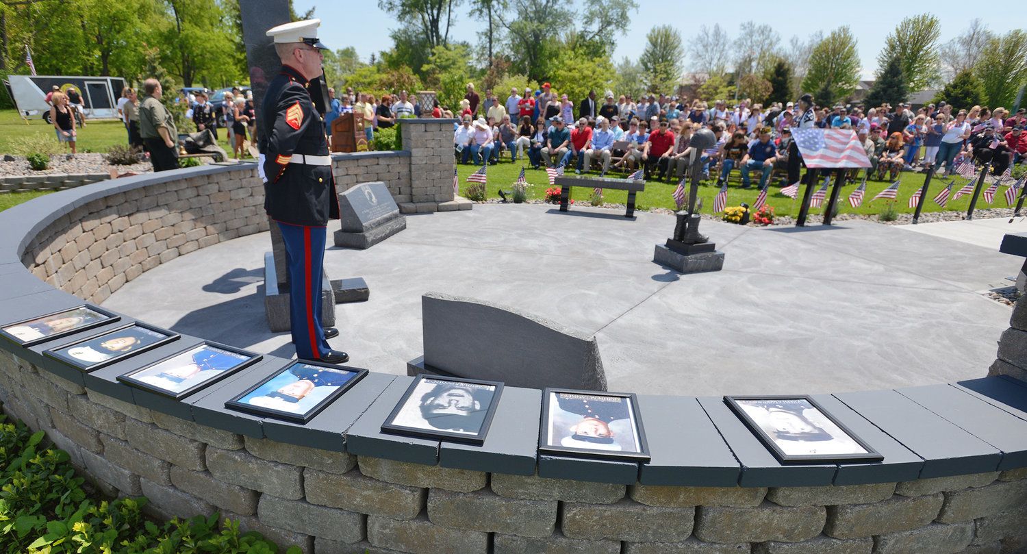 Portraits of seven of the 12 local Vietnam soldiers killed in Vietnam