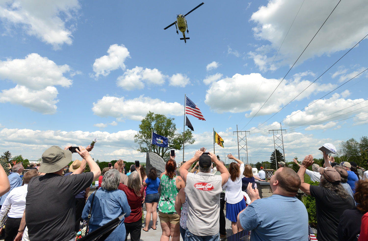 A huey helicopter does a fly over at the conclusion of the ceremony to dedicate the new Vietnam memorial.