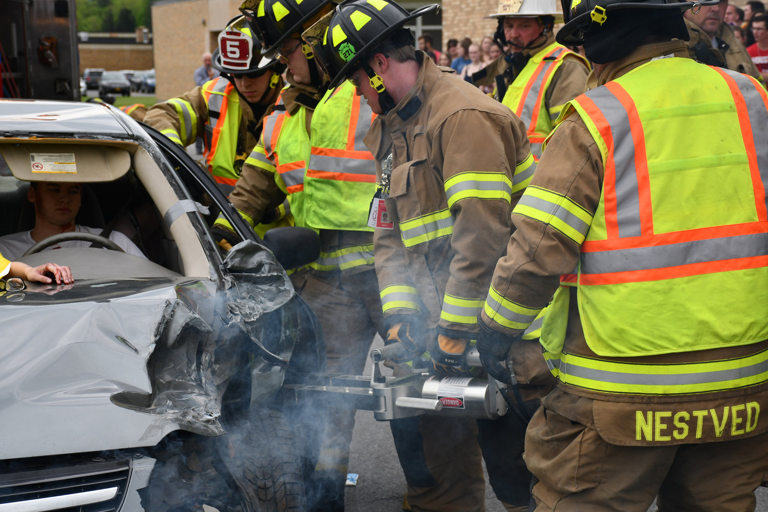 "PEEL IT BACK — Westmoreland firefighters stage a mock accident rescue on Thursday, May 23 at Westmoreland Senior High School to demonstrate to students the possible consequences of distracted driving during this prom and graduation season. ""It's up to you to make good choices,"" said Waylan Wilczek, 1st captain of the Westmoreland Fire Department."