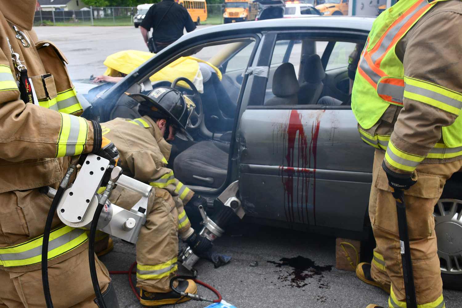 JAWS OF LIFE — Firefighters use hydraulic rescue tools to remove the driver's side rear door and extract a mock accident victim.