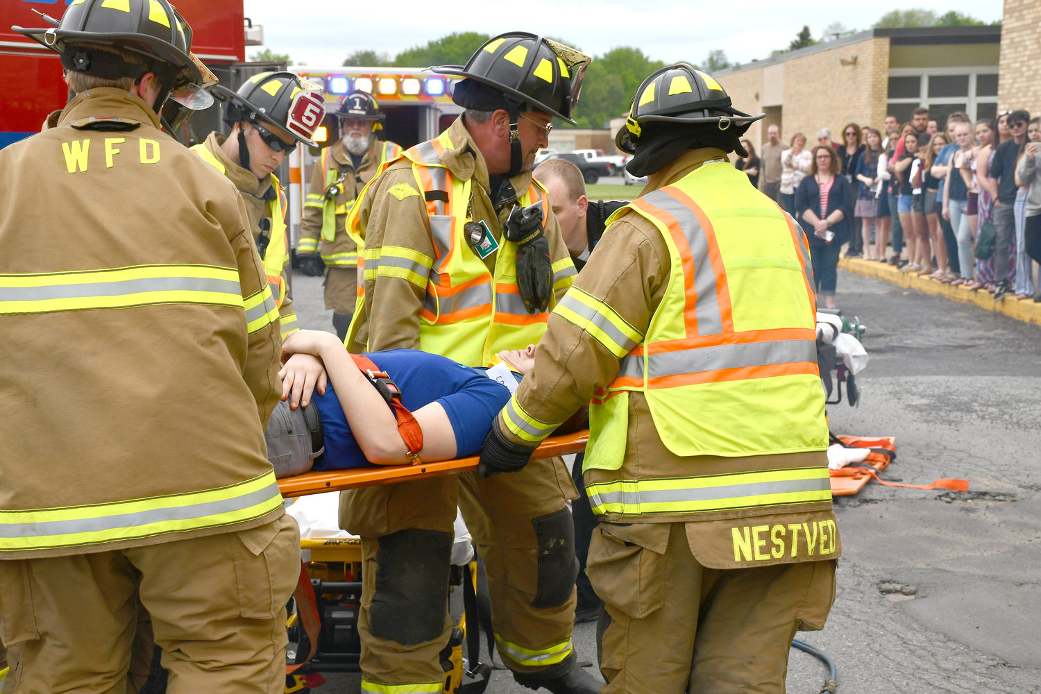 BACKBOARDED — Westmoreland firefighters extract and backboard a mock accident victim as part of a staged vehicular fatality accident scene to demonstrate the possible consequences of distracted driving to Westmoreland Senior High School students on Thursday, May 23 at the Westmoreland school bus garage parking lot. Motor vehicle crashes are the leading cause of death of U.S. teens. Six teens, ages 16-19 die every day from motor vehicle injuries, according to the Center of Disease Control and Prevention.