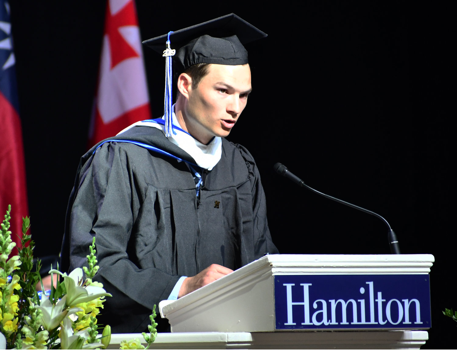 PRIZE WINNER — Hamilton graduate John R. Stickel accepts the James Soper Merrill Prize, awarded to the graduate who in character and influence, best typifies the highest ideals of the college, at the Margaret Bundy Scott Field House on Sunday, May 26 during the Hamilton College Class of 2019 commencement ceremony.