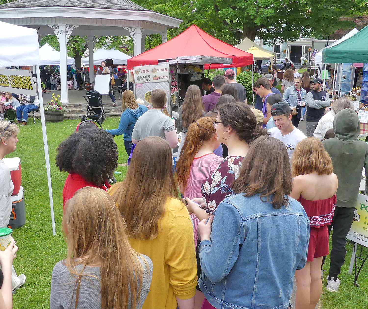CROWD PLEASING — Patrons line up at the busy food vendors at last year's Clinton Farmers Market.