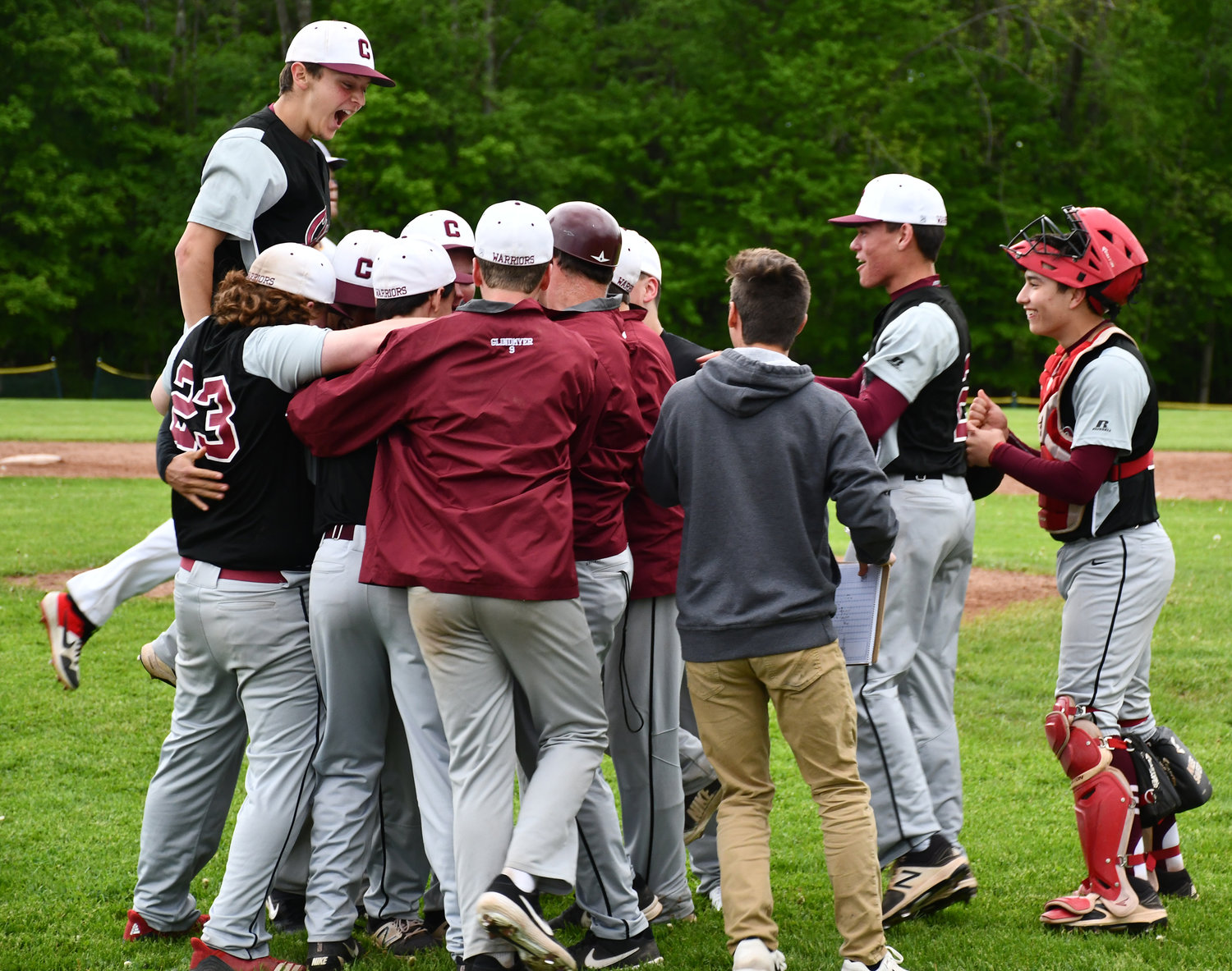 UPSET SPECIAL — The 16th seeded Clinton Warriors ousted the top seed Holland Patent Golden Knights 5-3 in the Section III Class B baseball playoffs on Friday, May 24. The team swarmed winning pitcher Joel Cleveland after the final out. The Warriors were coming off an 18-2 win in the opening round against Cazenovia at home on Thursday, May 23. Clinton was slated to visit No. 8 seed Solvay on Tuesday, May 28.
