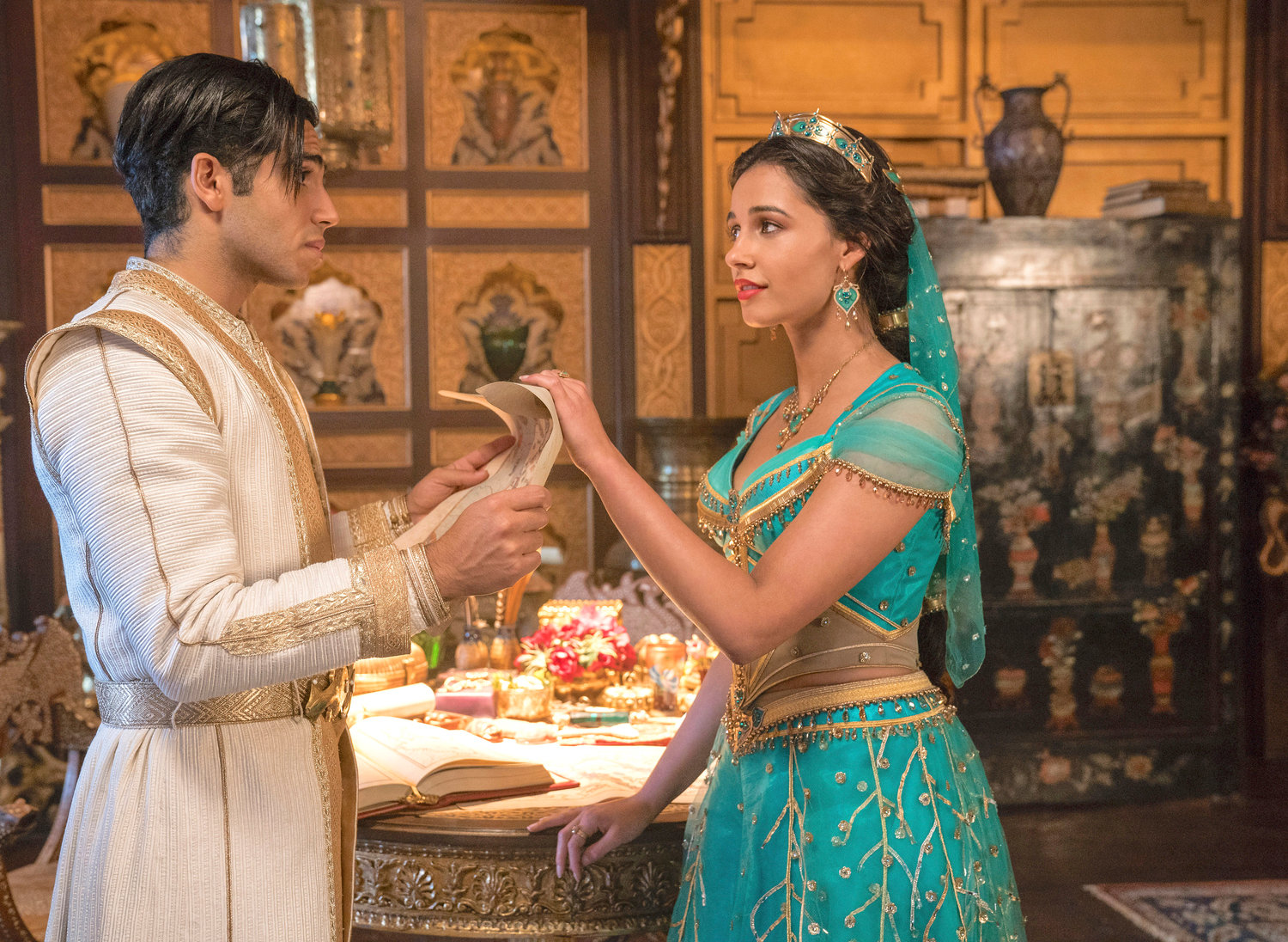 "MONEY MAKER — Mena Massoud is Aladdin and Naomi Scott is Jasmine in Disney's live-action adaptation of the 1992 animated classic ""Aladdin."""