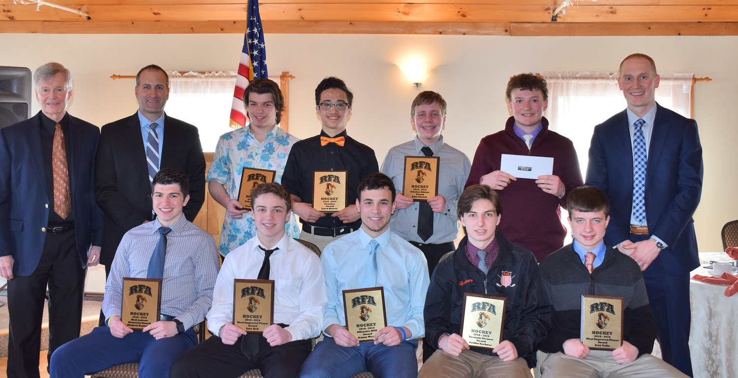 RFA HOCKEY AWARDS — The Rome Free Academy ice hockey team gave out awards at its banquet. From left, in the front row are: Michael Bostwick (Rick LeFevre Memorial Award), Jake Hall (Most Improved), Danny Mecca (Offensive MVP), Griffin Eychner (Vacuum Cleaner Award) and Joey Gulla (Most Improved). In the back row, from left, are: assistant coach Bill Fleet, assistant coach Dave Petrelli, Isaiah Nebush (Defensive MVP), Jared Hussey (Coach's Award), Jon Denton (Scholar Athlete), Aaron Simons (Bobby T. Ciccotti Memorial Award) and head coach Jason Nowicki.