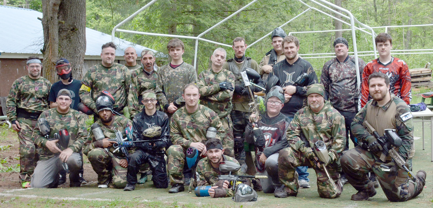 "PAINTBALL PLATOON—The members of the Ghost paintball team come to AAA Paintball Park in Constantia to relax, have a good time with friends and splatter them with as much paint as possible. From left bottom row: John Winks, Zack Frank, Jeremiah Brown, Brad Delavan,Taylor Parameter, Rhys Napolitano, Tony Napolitano, Jesse Duncan. Back row from left: Travis Scott, Tyler Harris, John Wedin, Chris George, Chris Jones, Max Creamer, Fred ""Moses"" Koegel, Matthew Wilkinson, J. Geoffrey Kasin, Nathan Stewart, Gus Smith, Zack Welsh."
