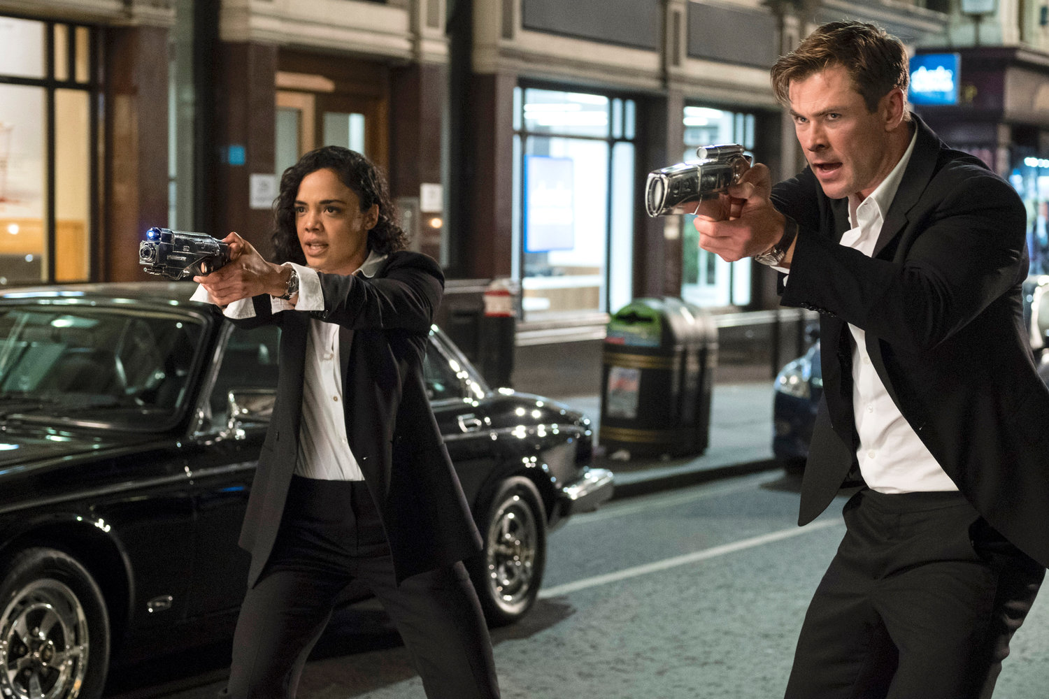 "MIB IS BACK — Em (Tessa Thompson) and H (Chris Hemsworth) in a scene from ""Men in Black International."""