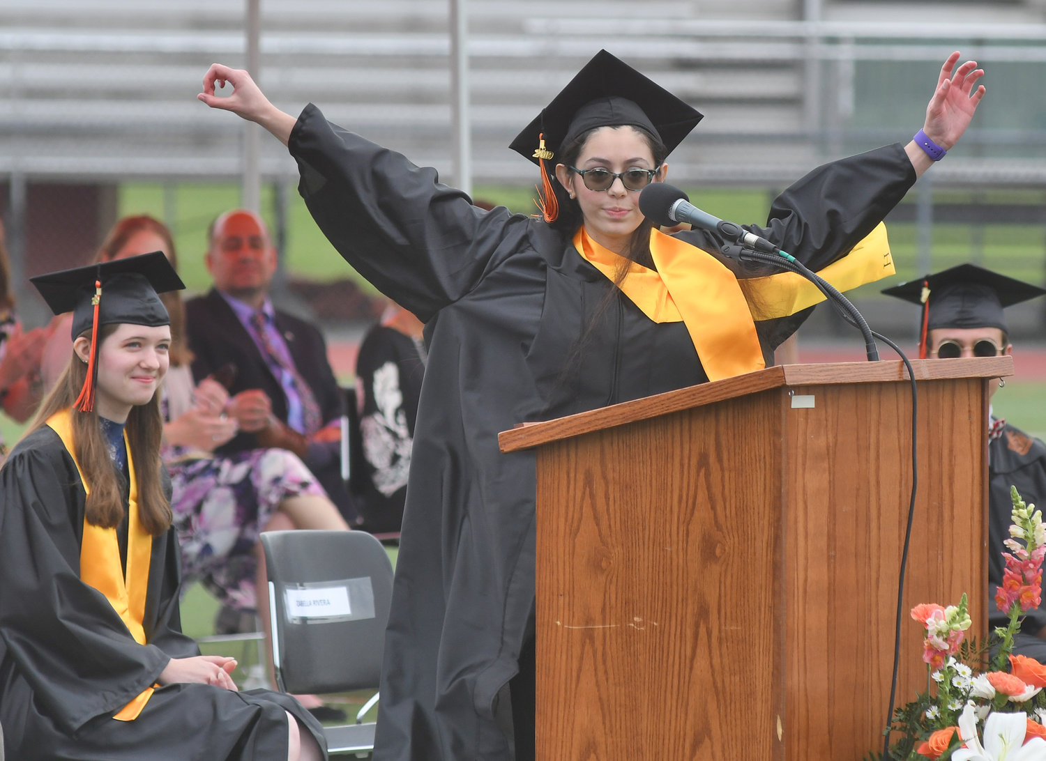 SPECIAL SALUTATORIAN SALUTE — Rome Free Academy salutatorian Izabella Rivera closes her address with a color guard salute during RFA's commencement Saturday.
