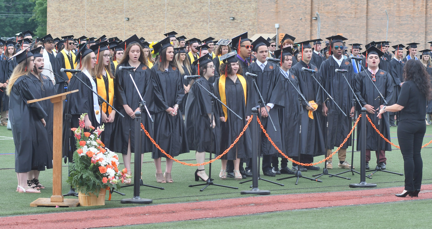ALMA MATER RFA! — The Rome Free Academy Concert Choir sings the alma mater, conducted by Michelle Rushford, during RFA's 150th commencement Saturday.