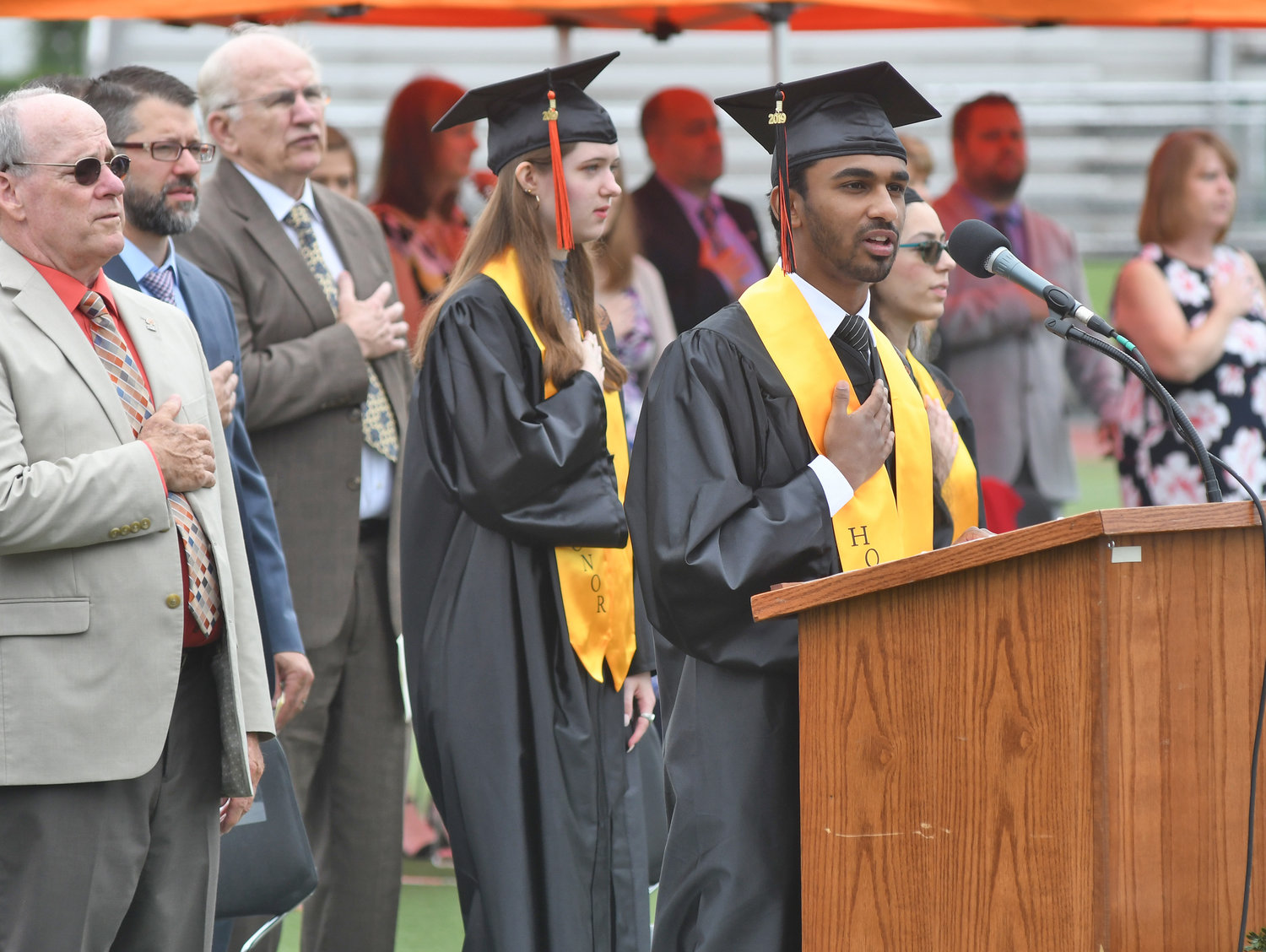LEADING THE PLEDGE — Rome Free Academy student association President John George, at right, leads the Pledge of Allegiance during RFA's 150th commencement Saturday.