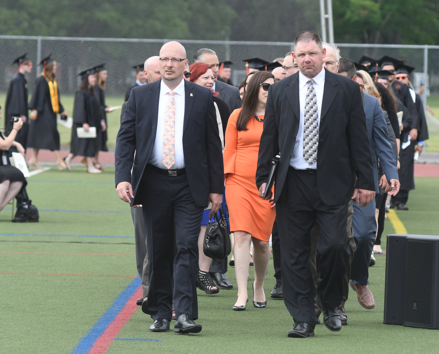 HERE COMES THE PROCESSIONAL — Rome school district Superintendent Peter C. Blake, at left, and Rome Free Academy Principal Brian LeBaron lead the processional for the start of Rome Free Academy's 150th commencement Saturday.