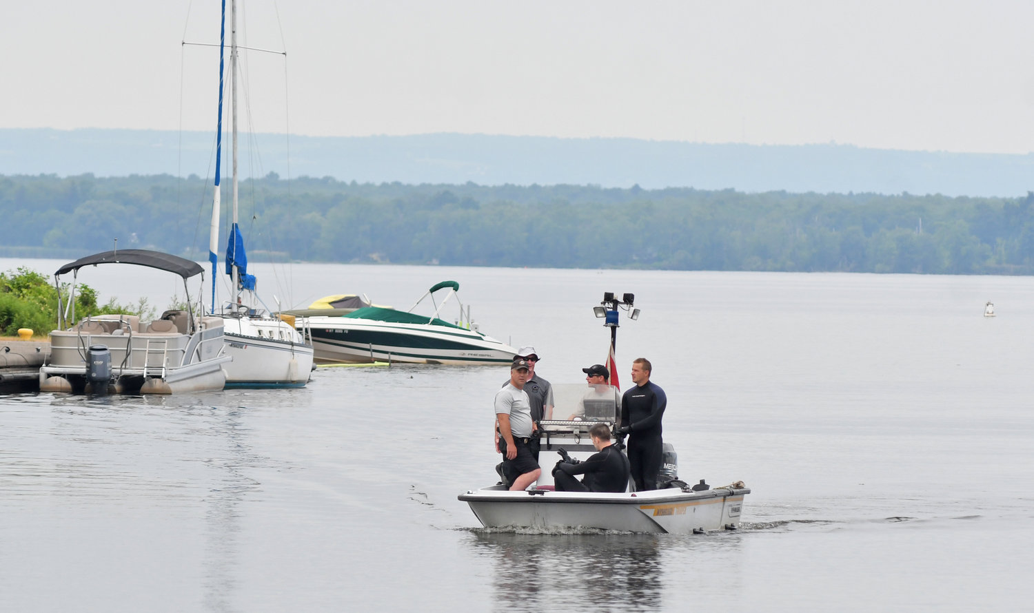 MISSING — Divers from State Police Troop D in Oneida return to dock in Sylvan Beach after searching for a missing diver Saturday morning.  The swimmer was reported missing early Friday evening after they went swimming off a boat, went under water and didn't come back up, according to law enforcement.