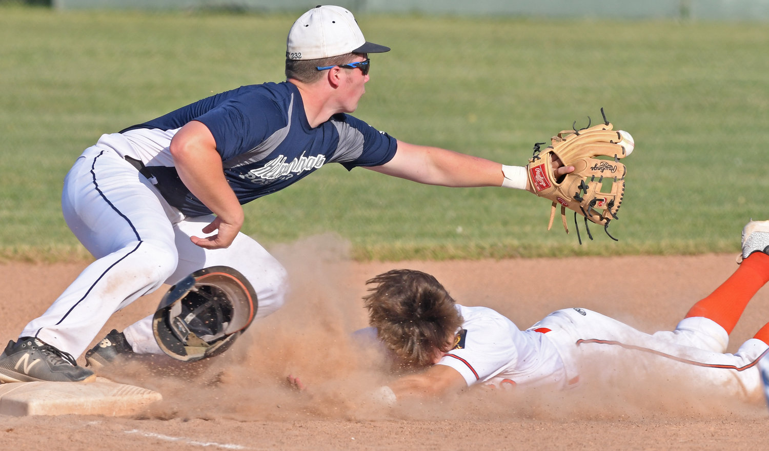 IN THERE — Smith Post's Riley Brawdy slides safely into third base just before the ball hits the glove of Helmuth-Ingalls third baseman Kodie Abrams. Brawdy had a hit, a run batted in and two runs scored as Smith won at home 12-2 Monday night.