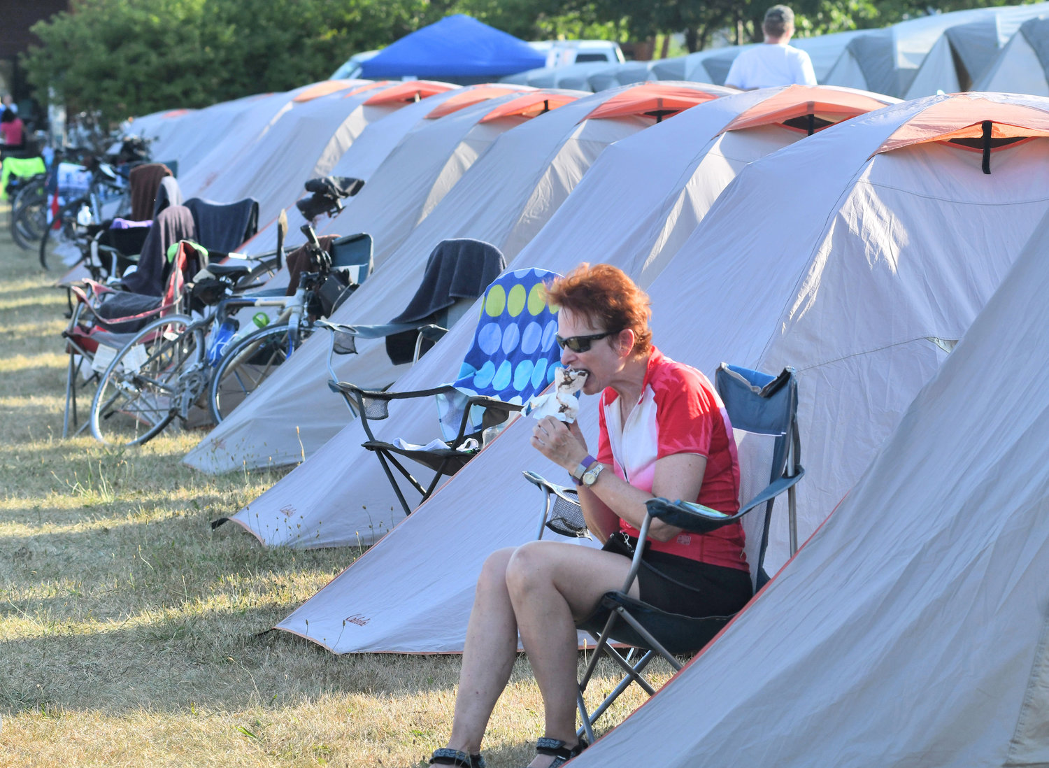 PIT STOP — Enolla Nelson from Raleigh, N.C., enjoys ice cream after a hot day on her bike, as riders during the 2018 Cycle the Erie Canal Bike Tour spent a night in Rome. More than 700 riders are expected to camp out on the Fort Stanwix lawn in this year's event on Thursday.