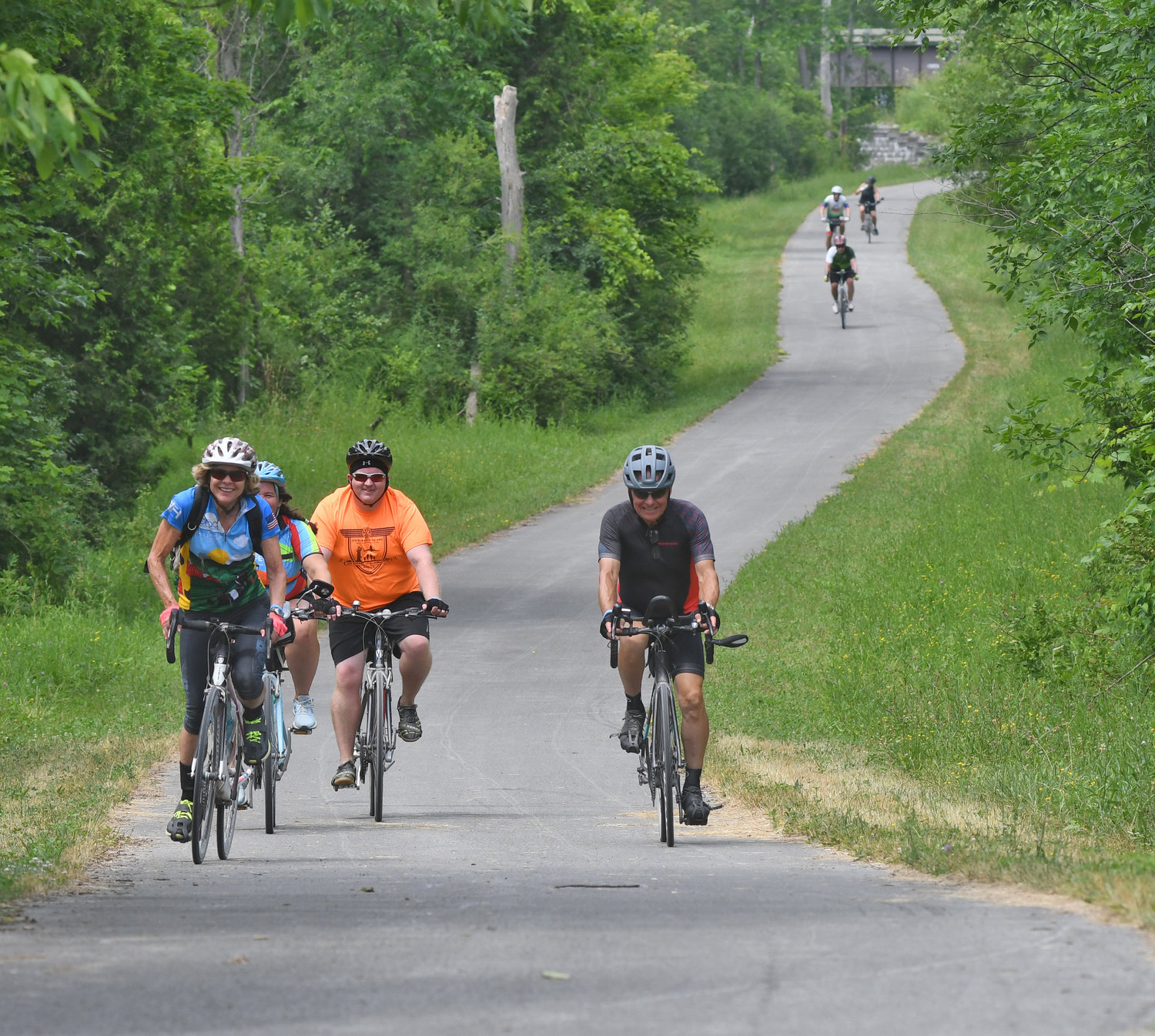 A gaggle of bicyclists make their way to Rome on the trail in New London late Thursday morning.