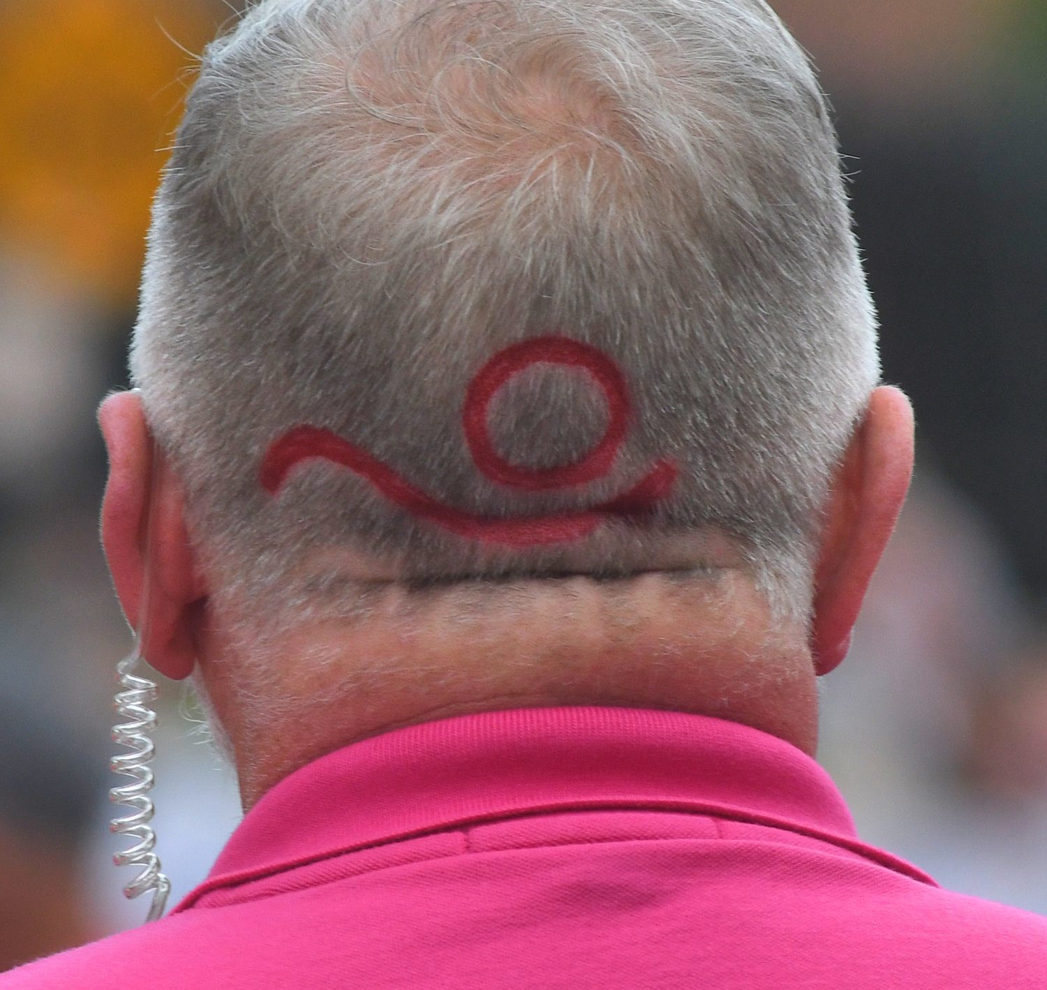Boilermaker logo emblazeened in the back of the head of a race official