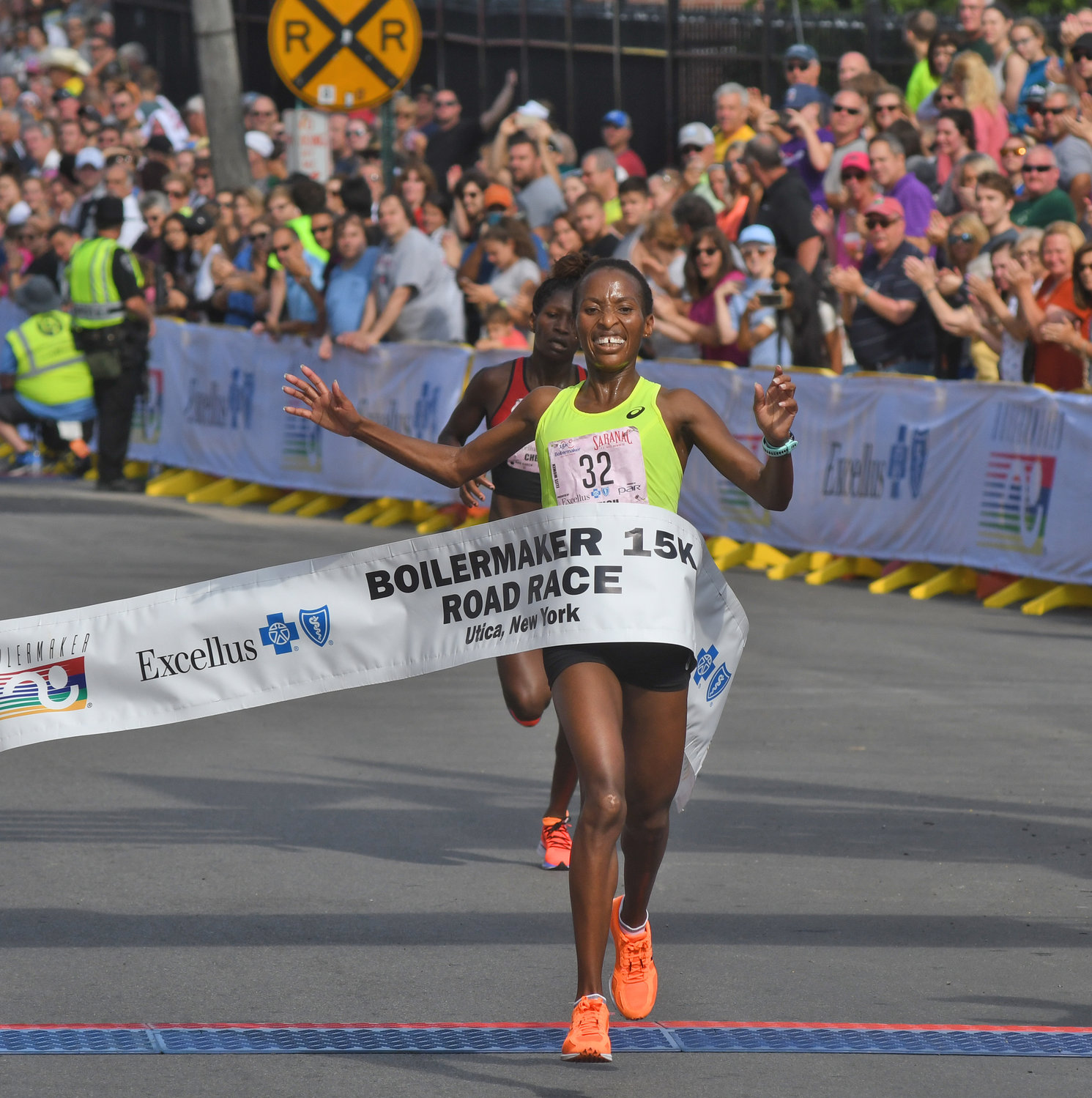 FIRST PLACE, BARELY — Caroline Rotich of Kenya finishes first among the women in the Boilermaker 15K, finishing in 49:07, just two seconds ahead of fellow Kenyan Iveen Chepkemoi in the background. Rotich was the 2015 Boston Marathon champion.