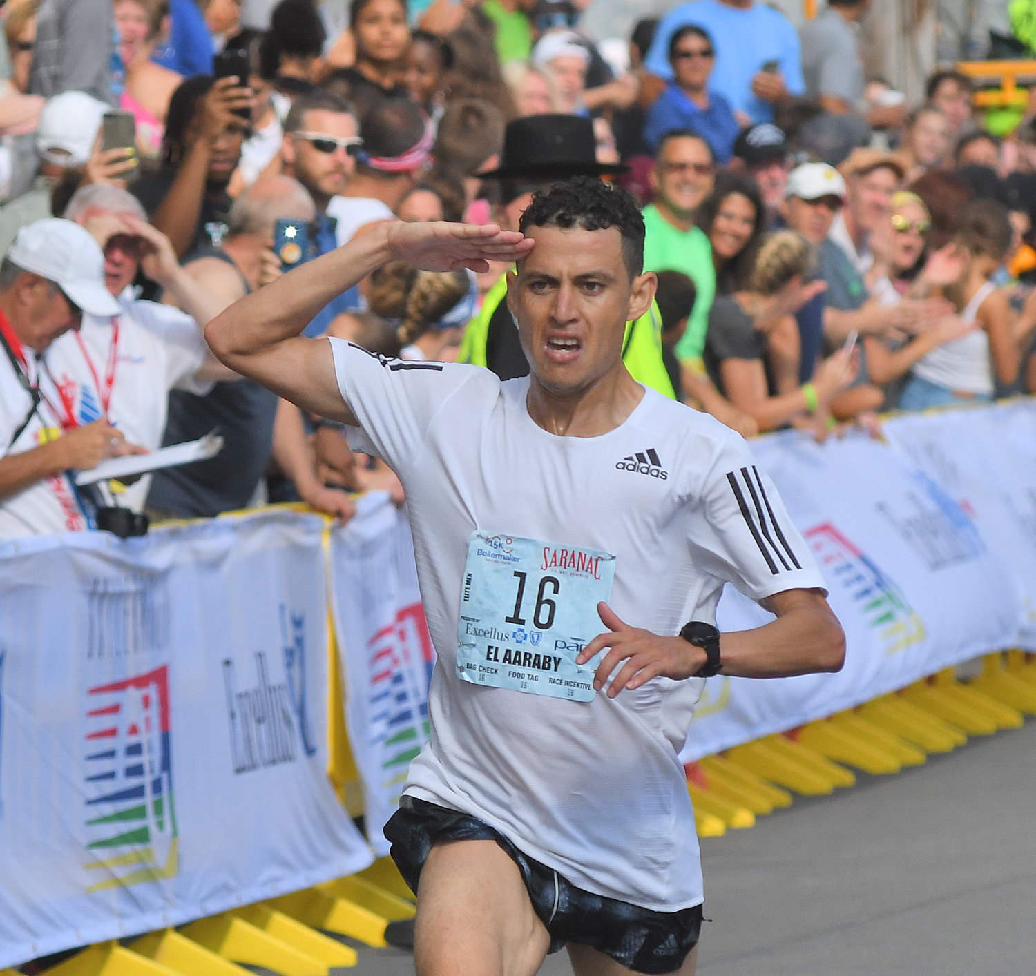 SECOND-BEST — Mohamed Reda El Aaraby salutes as he crosses the finish line in second place at the Boilermaker 15K Sunday. The Moroccan's time of 43:39 was three seconds behind the winning time.