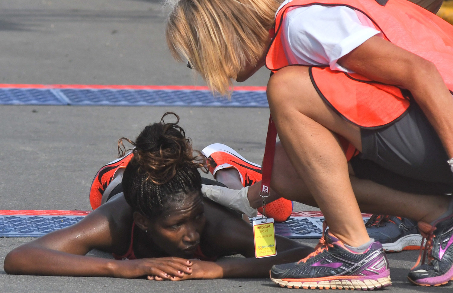 OUT OF GAS — Iveen Chepkemol lays out after coming in second in the women's 15K at the Boilermaker Sunday. The Kenyan's time of 49:09 was two seconds off the winning pace.