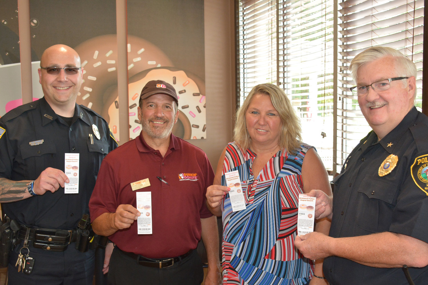 FREE DOUGHNUTS — The Kirkland Police Department along with the Clinton Dunkin' Donuts is partnering to hand out Good Citizen Awards for obeying the laws and being a good citizen of Clinton and Kirkland. Pictured from left are Officer Shawn Occhipinti, Dunkin' Donuts Manager Jim Hulser, Dunkin' Donuts Multi-Unit Manager Trudy Pellerito and Kirkland Chief of Police Dan English.