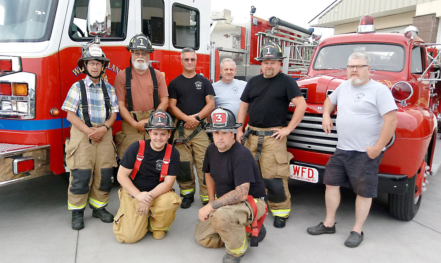 HAPPY ANNIVERSARY — Members of Westmoreland Volunteer Fire Department gather in front of some of their current and vintage rigs. The department is celebrating 75 years of serving the community with a big celebration planned for Saturday, July 20.