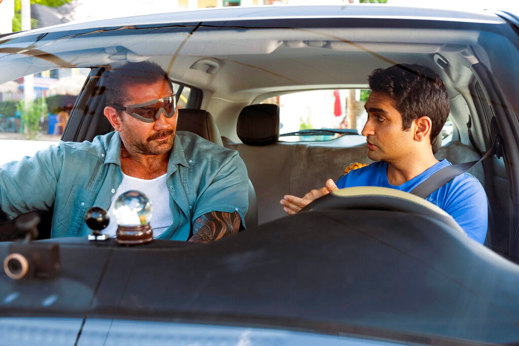 "This image released by 20th Century Fox shows Dave Bautista, left, and Kumail Nanjiani in a scene from ""Stuber."" (Mark Hill/20th Century Fox via AP)"