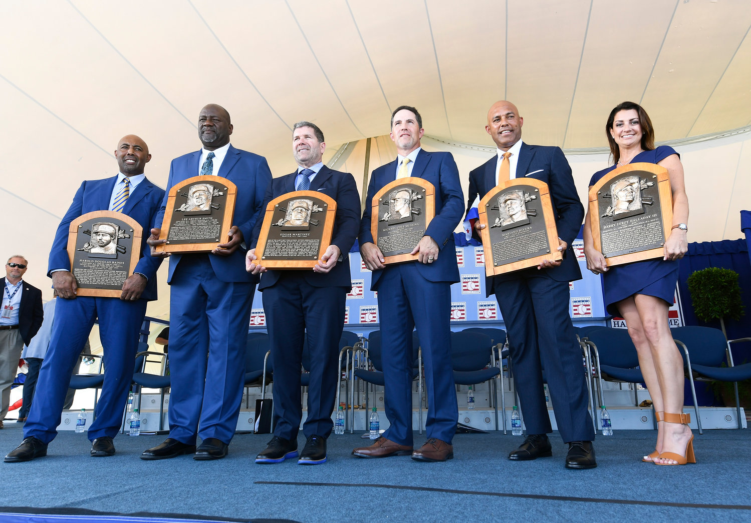 HALL OF FAME LINEUP — National Baseball Hall of Fame inductees, from left, Harold Baines, Lee Smith, Edgar Martinez, Mike Mussina, Mariano Rivera are joined on the stage by Brandy Halladay, widow of the late Roy Halladay, following the induction ceremony on Sunday, July 21 at the Clark Sports Center in Cooperstown.