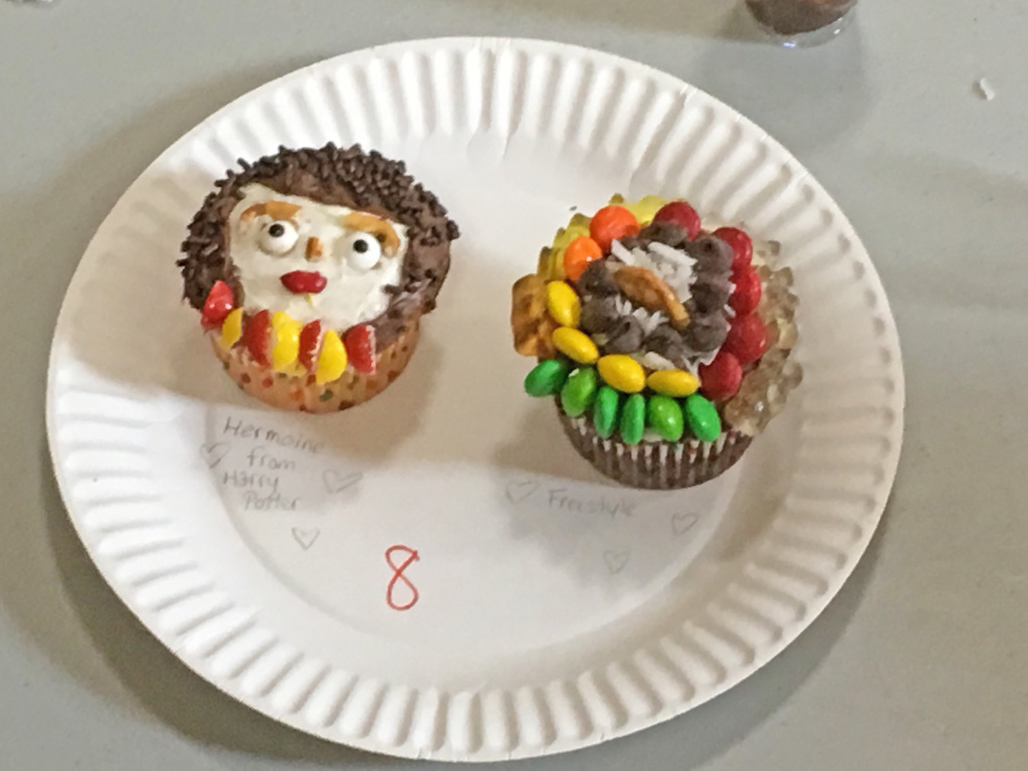 WINNING DESIGN — Hermione, the famous young witch of the Hogwarts School of Witchcraft and Wizardry from the now classic children's book series, Harry Potter, by J.K. Rowling, comes to life through a cupcake at left.