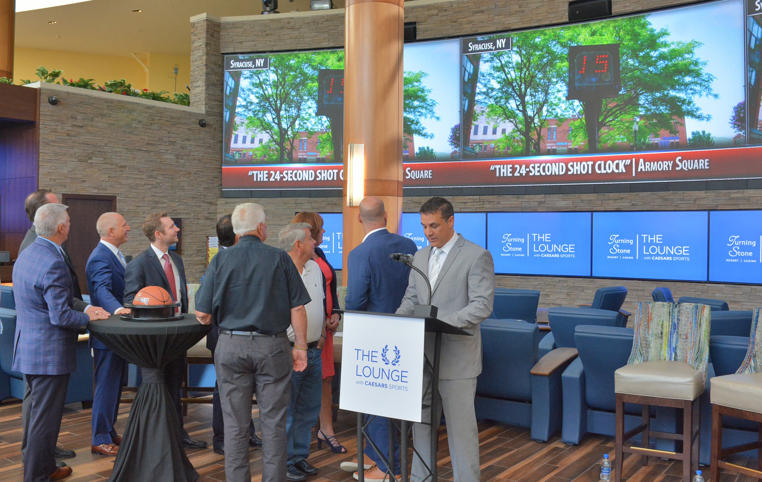 "WATCHING THE CLOCK— Gaming officials, along with local politicians, watch the 24-second- shot-clock located in Armory Square in Syracuse signaling the official opening of ""The Lounge with Caesars Sports"" sport book at the Turning Stone Casino in Verona on Thursday, Aug. 1."