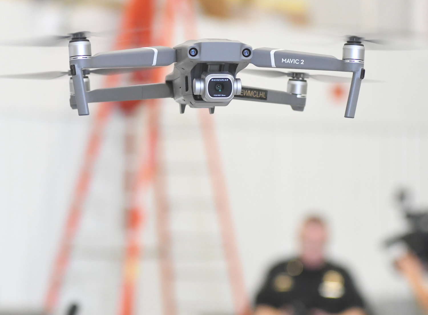 UP, UP AND AWAY — A Mavic Pro drone hovers a few feet above ground as part of Sheriff Robert M. Maciol's new drone unit rollout this morning. This battery-powered camera drone is one of eight in the new fleet, and costs about $1,000.