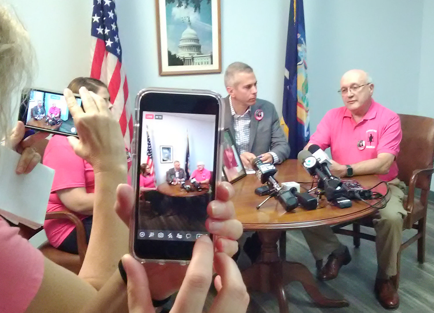 SEEKING SOCIAL-MEDIA ACCOUNTABILITY — Frank Williams, right, speaks to reporters Wednesday at the Utica district office of Congressman Anthony Brindisi, D-22nd Dist., center, about how to keep graphic and  disturbing content off social media platforms. At left is Kimberly Devins, Williams' daughter and mother of Bianca Devins, shown in the photo on the table, who was killed July 14 in Utica. Police say her killer took photos of her body then shared them on social media. The Devins family was then subjected to harassment that included some of the images.