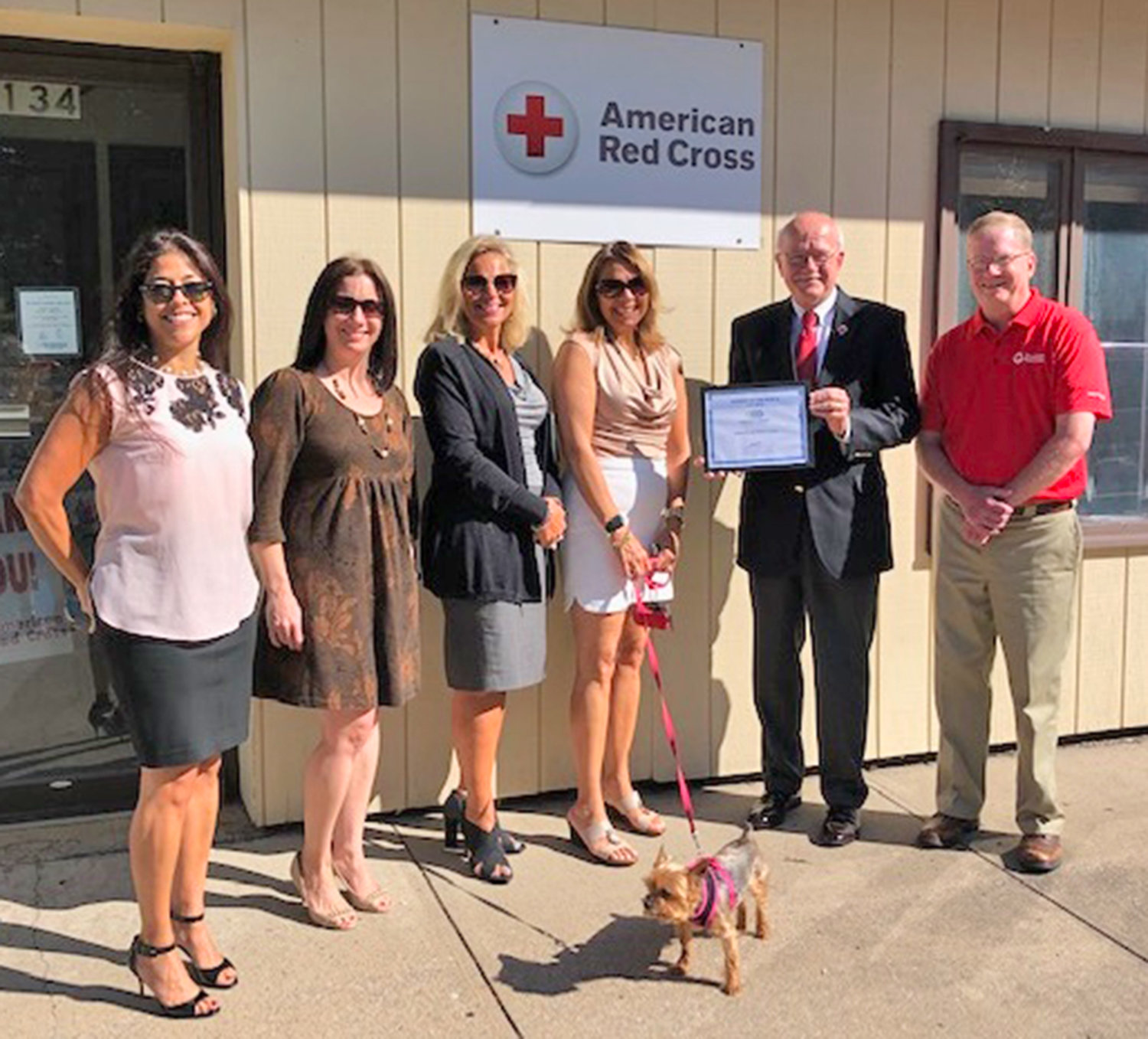 THANKS! — Members of the Oneida Chamber of Commerce pose with American Red Cross officials in Oneida recently.  The chamber has honored the chapter as its Business of the Month.
