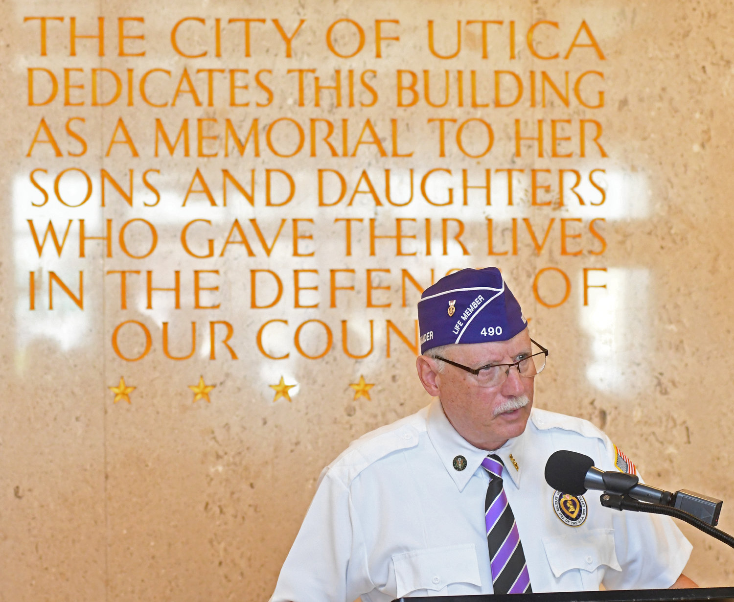 Joe Fraccola commander of the Central NY Chapter 490 of the Military Order of the Purple Heart speaks at the Adirondack Bank Center Purple Heart observance Wednesday afternoon.