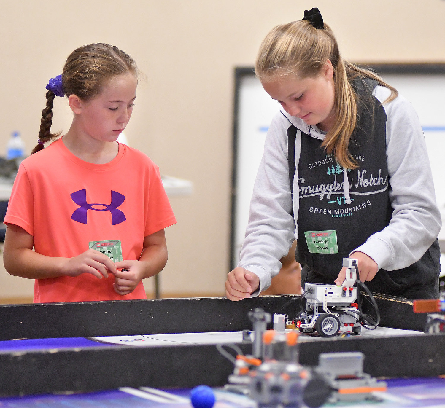 SPECIAL ADJUSTMENTS — Sisters Amber Shenk, 5, and Camryn Shenk, 7, of Camden make adjustments to their Lego robot during a STEM Outreach Program camp Wednesday at Griffiss Institute.