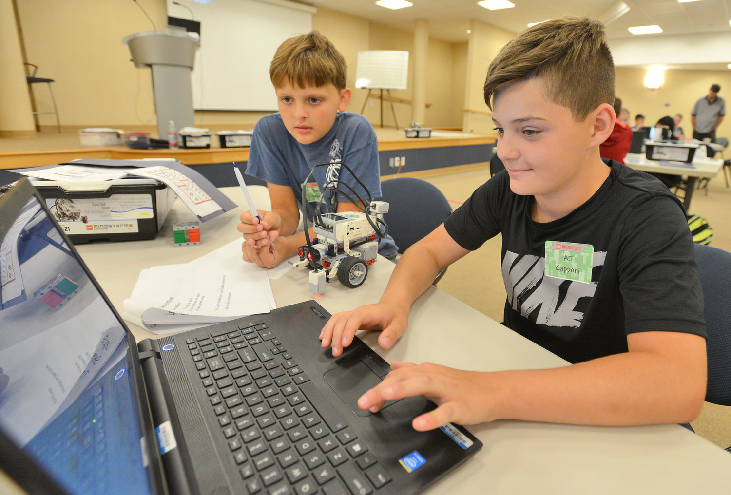 SETTING UP THEIR ROBOT — Clinton Elementary School students Jason Leonard and AJ Capponi work on programming their Lego robot at a STEM Outreach Program camp Wednesday at Griffiss Institute.