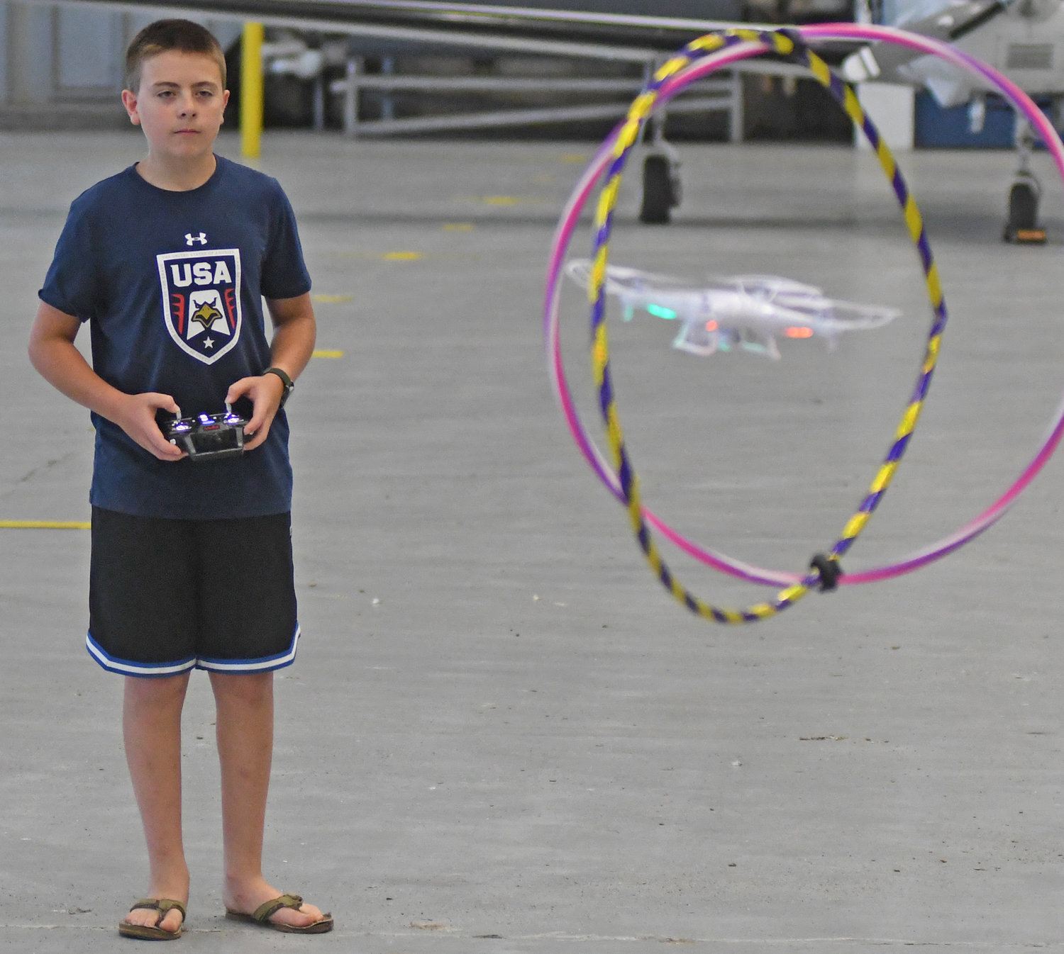 Alex Brzuszkiewicz from Oneida practices flying a drone at Building 100 before the obstacle course competition begins on Thursday.