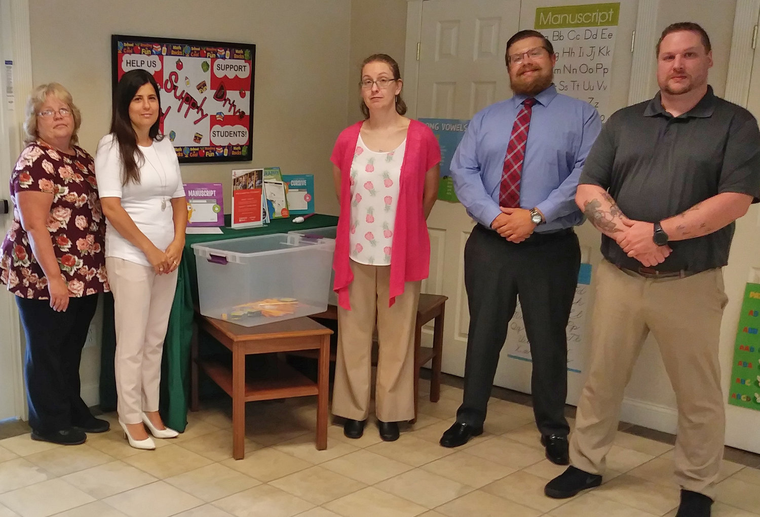 HELPING KIDS — The Community Bank N.A. branch in Vernon, 5238 W. Seneca St., is holding its annual school supply drive to benefit students in the Vernon-Verona-Sherrill School District. Among those involved in the effort are, from left: Kelley Kimball, bank teller; Stacy Dangler, customer service representative; Lori Bartch, assistant manager; Willis Corney, branch manager; and Nicholas Bogart, teller.(Photo submitted)